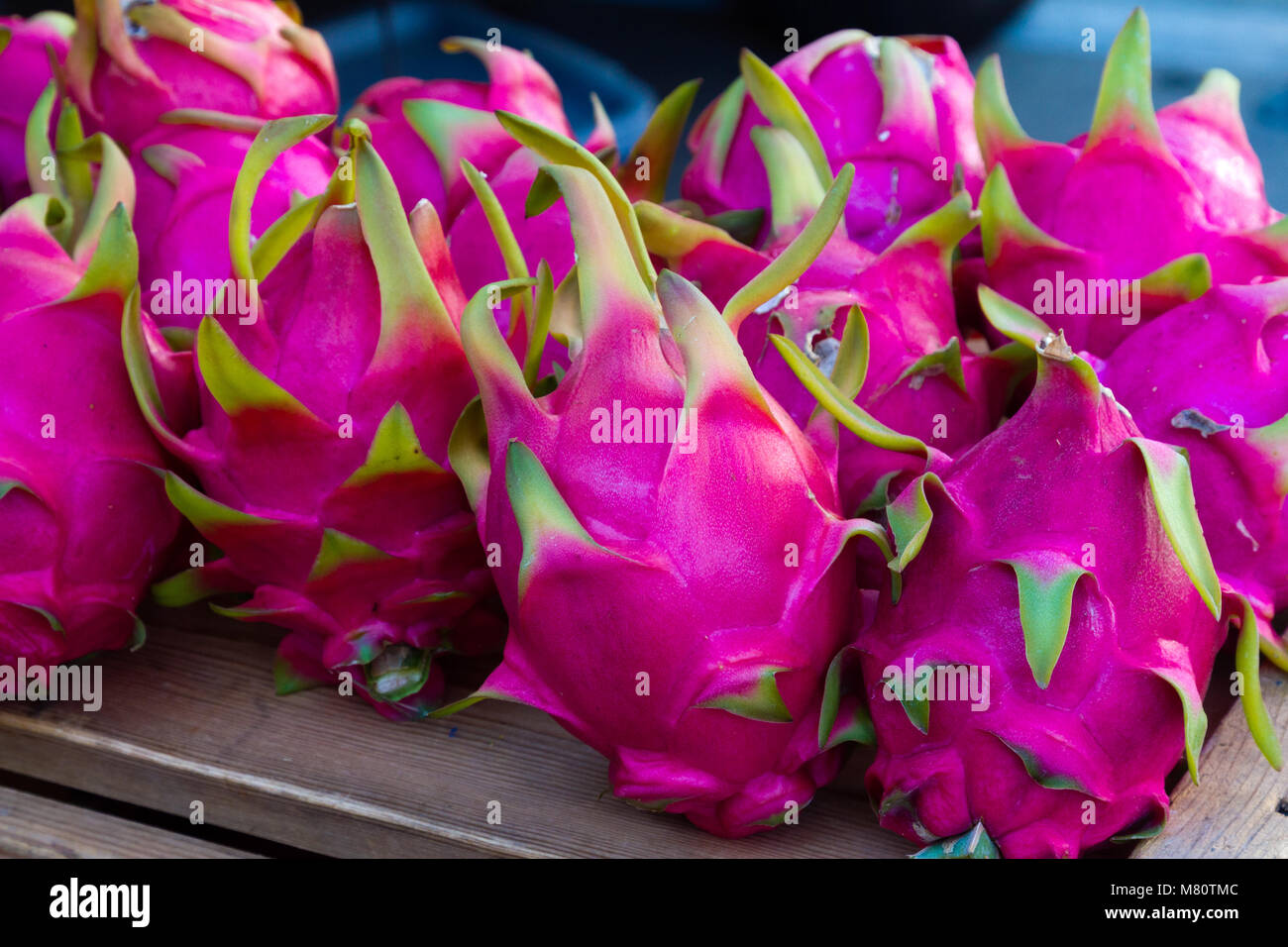 Exotic dragon fruit displayed for sale at a farmers market. - Stock Image