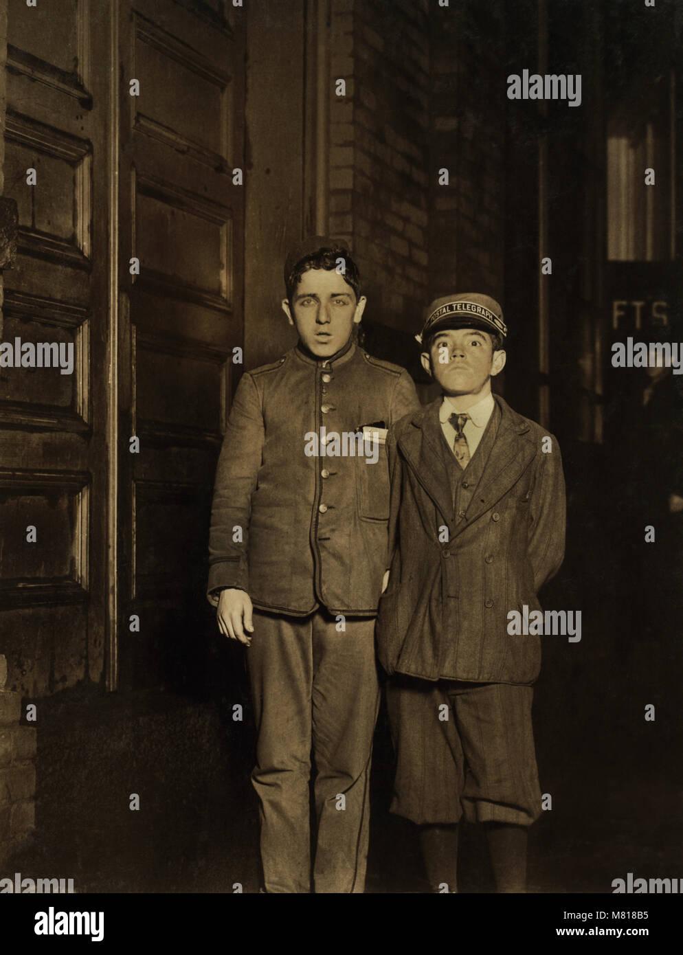 Samuel Weinstein and William Locke, Two Night Messengers, Portrait Standing, Falls River, Massachusetts, USA, Lewis - Stock Image