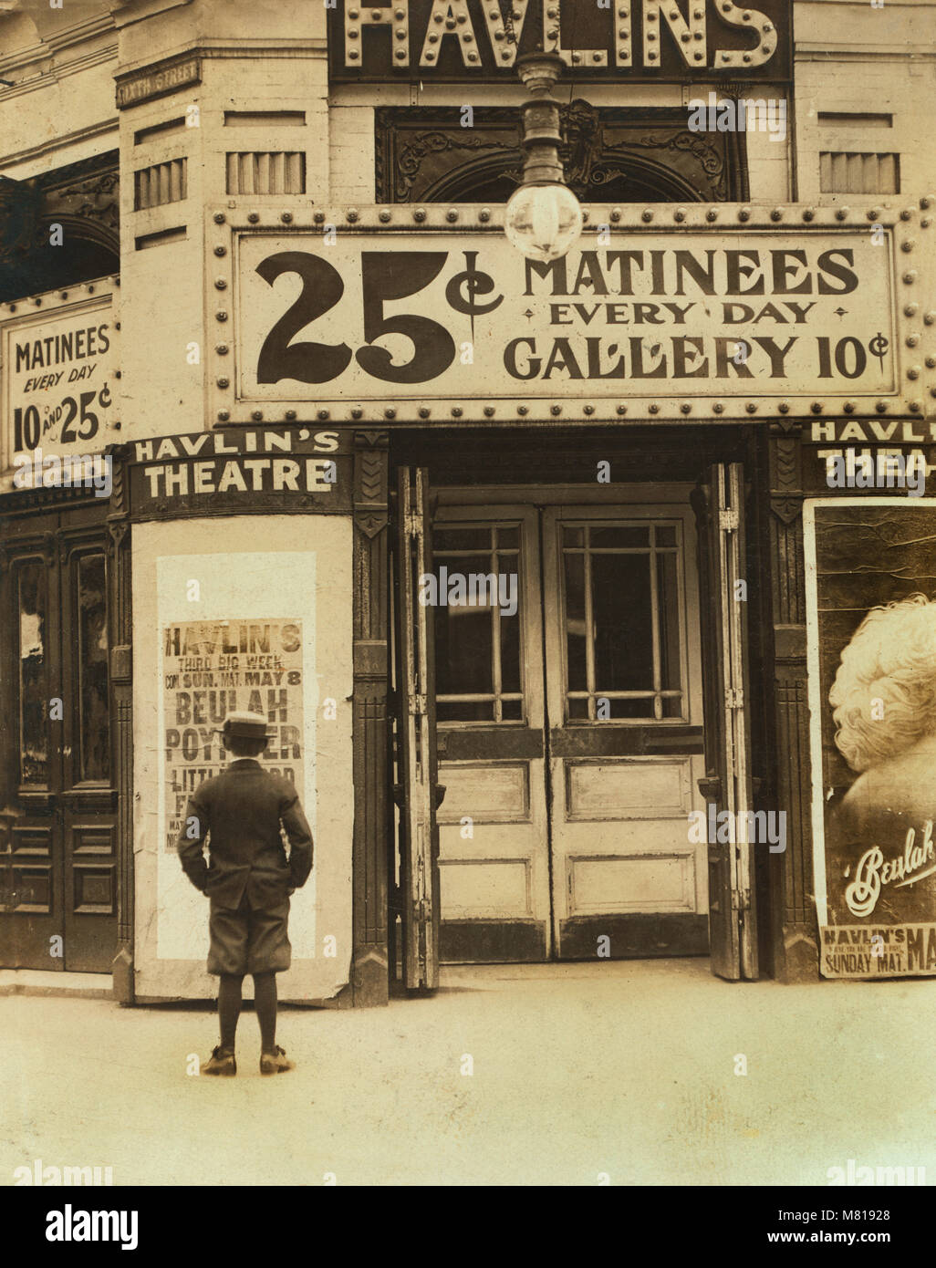 Young Boy Outside, Motion Picture Theater, St. Louis, Missouri, USA, Lewis Hine for National Child Labor Committee, - Stock Image