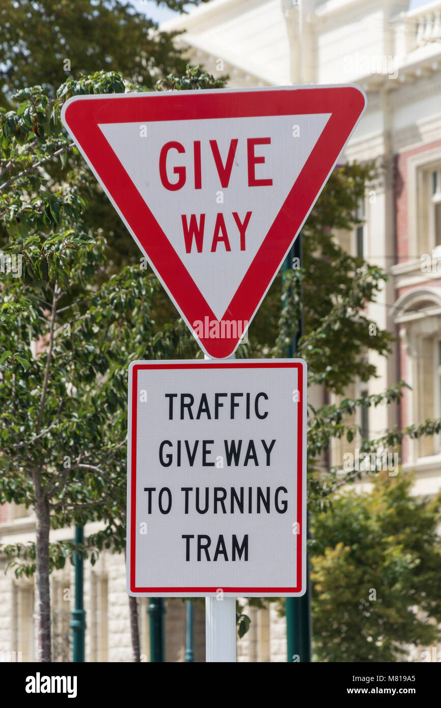 'Give way to turning tram' sign, Cathedral Square, Christchurch, Canterbury, New Zealand - Stock Image