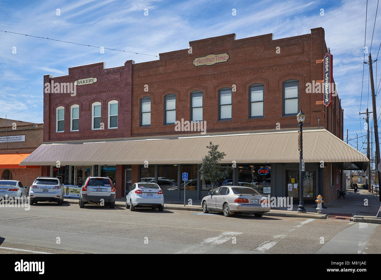 one of the many Old red brick buildings in Rosenberg, Texas, this building containing a Bakery and Soda Fountain - Stock Image
