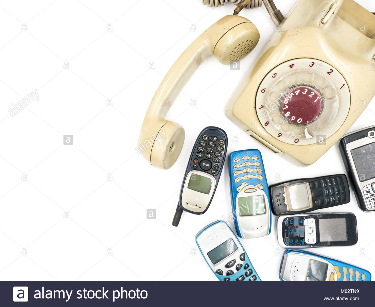 Old telephone and moblie phone on white background Stock Photo