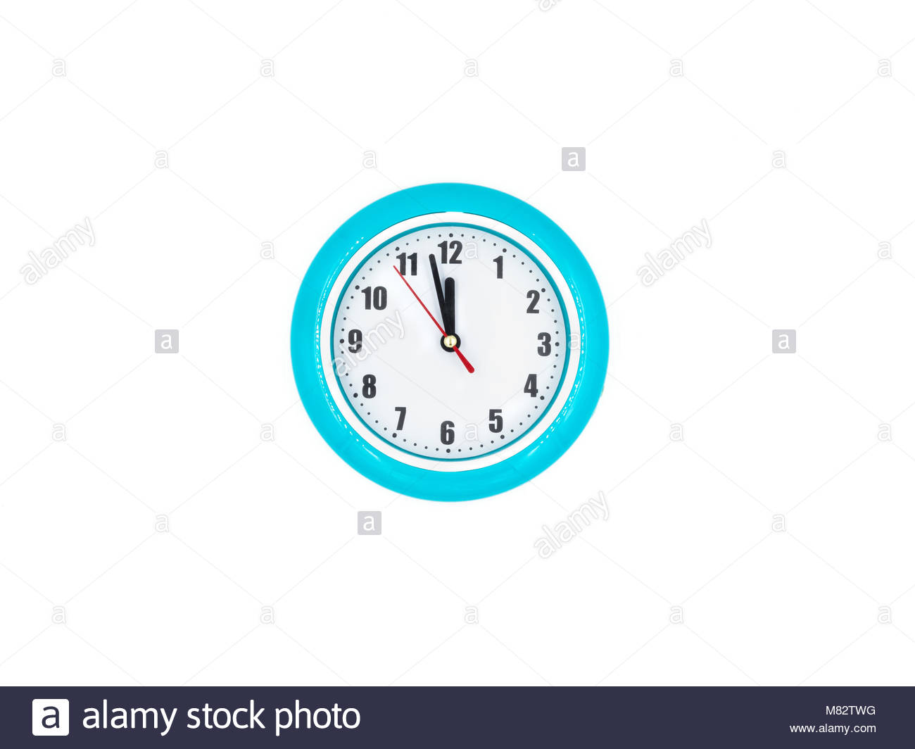 Blue wall clock on the white background, twelve o'clock - Stock Image
