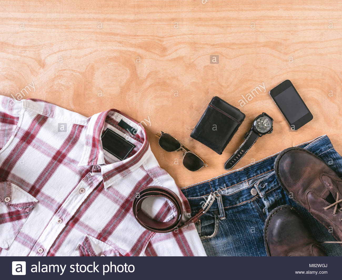 Top view of Men's casual outfits with accessories on wooden table background Stock Photo