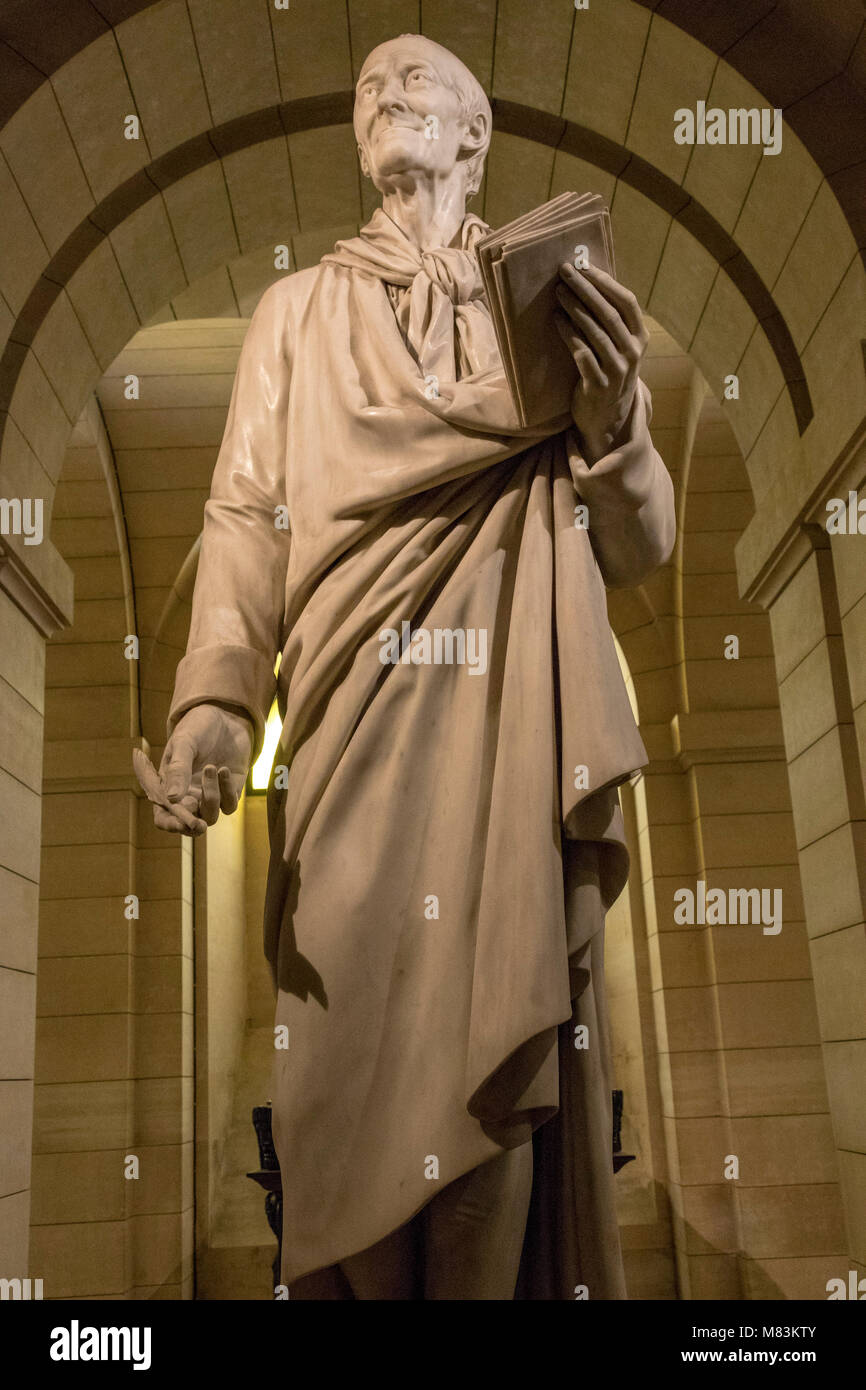 statue of Voltaire above his tomb, crypt of the Pantheon, Paris, France - Stock Image