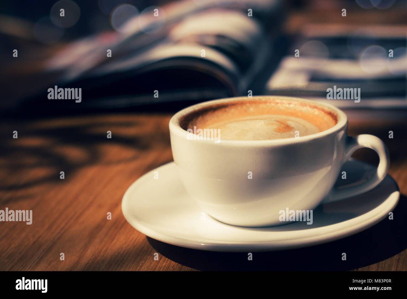 cup of coffee in cafee in dark tone and vintage - Stock Image
