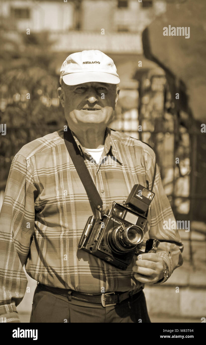 Photographer with old camera shooting outdoor, Damaskus, Syria - Stock Image
