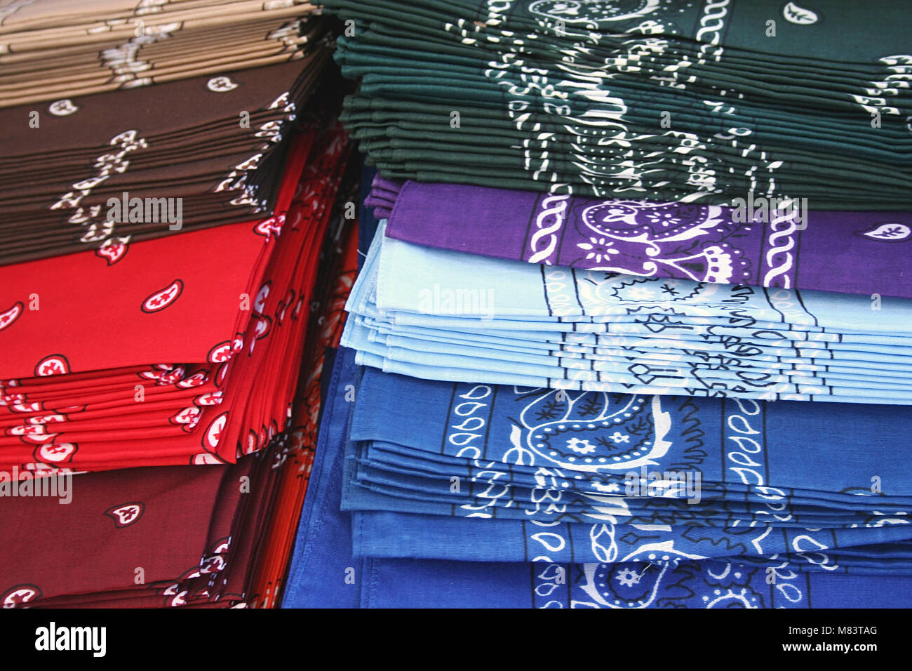 Different colored Bandanas layed out for sale - Stock Image