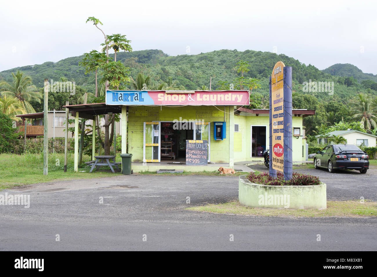Laundrette and shop on the roadside in Rarotonga the Cook Islands south pacific tropical Island - Stock Image