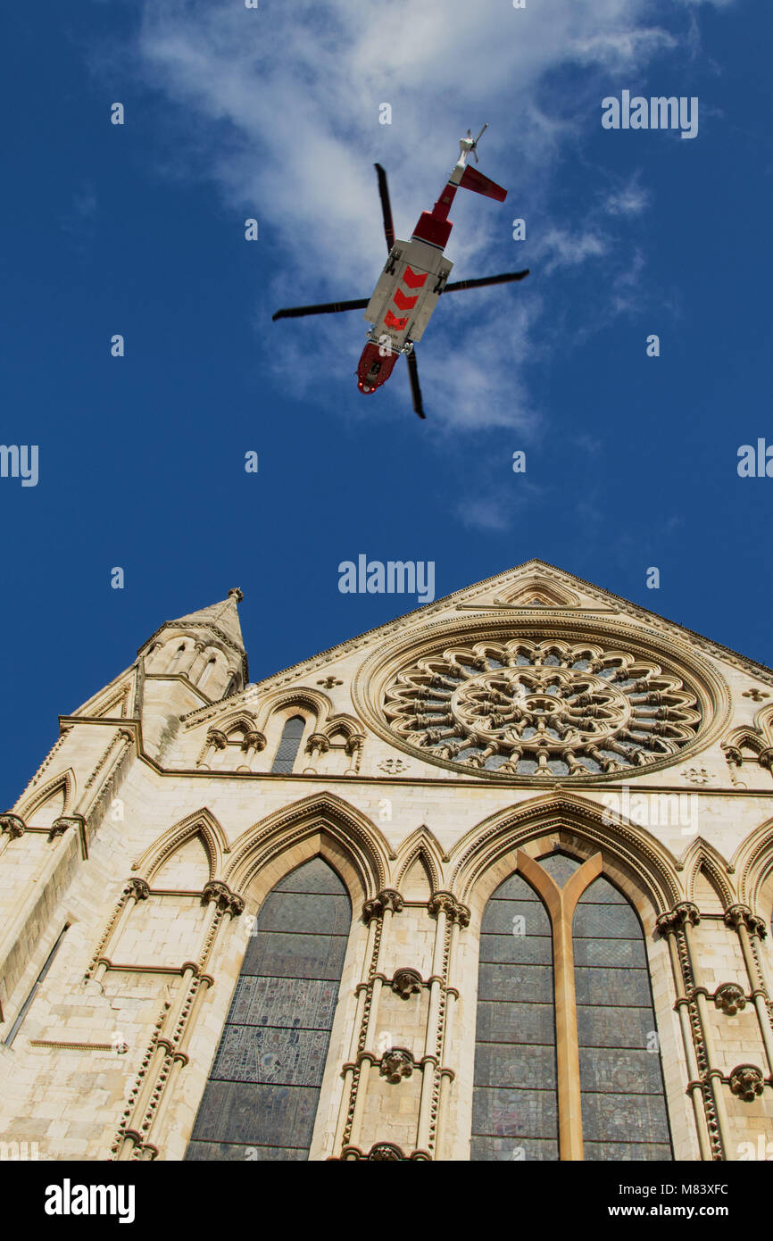Air sea rescue Helicopter flying towards York Minster,North Yorkshire,England,UK. - Stock Image