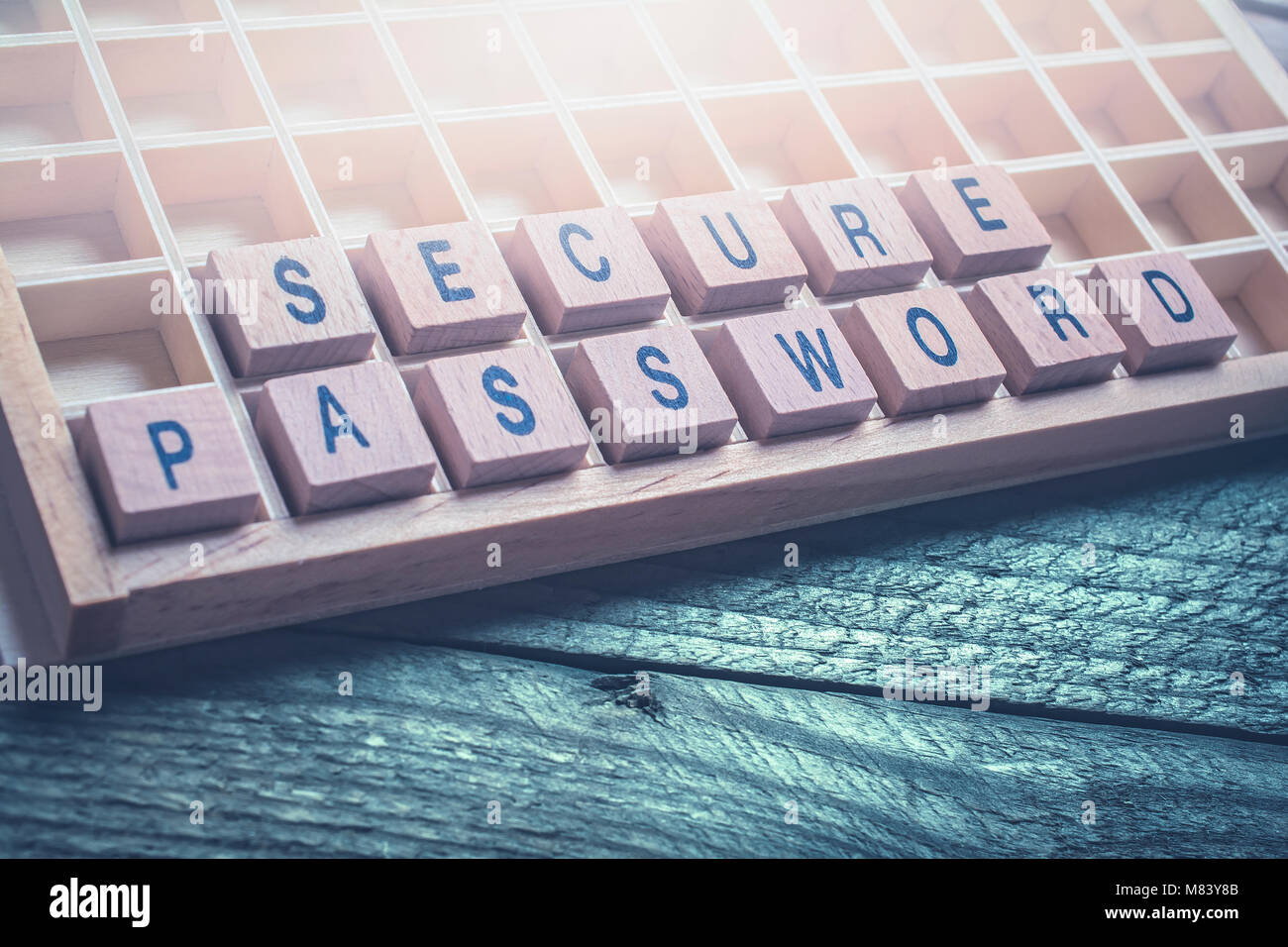 Closeup Of The Words Secure Password Formed By Wooden Blocks On A Wooden Floor - Stock Image