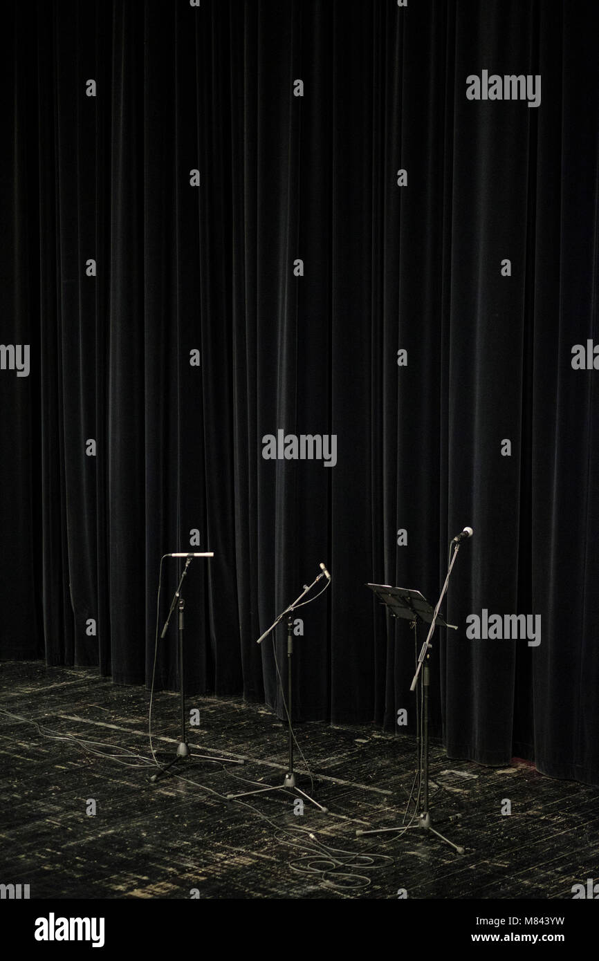 Microphones on an empty stage - Stock Image