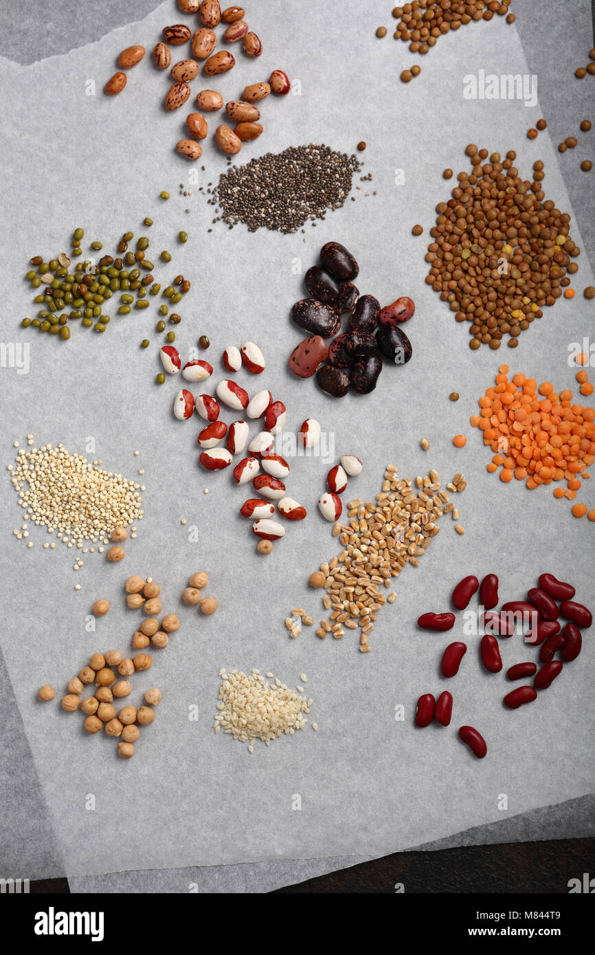 Set of super foods seeds on white - Stock Image