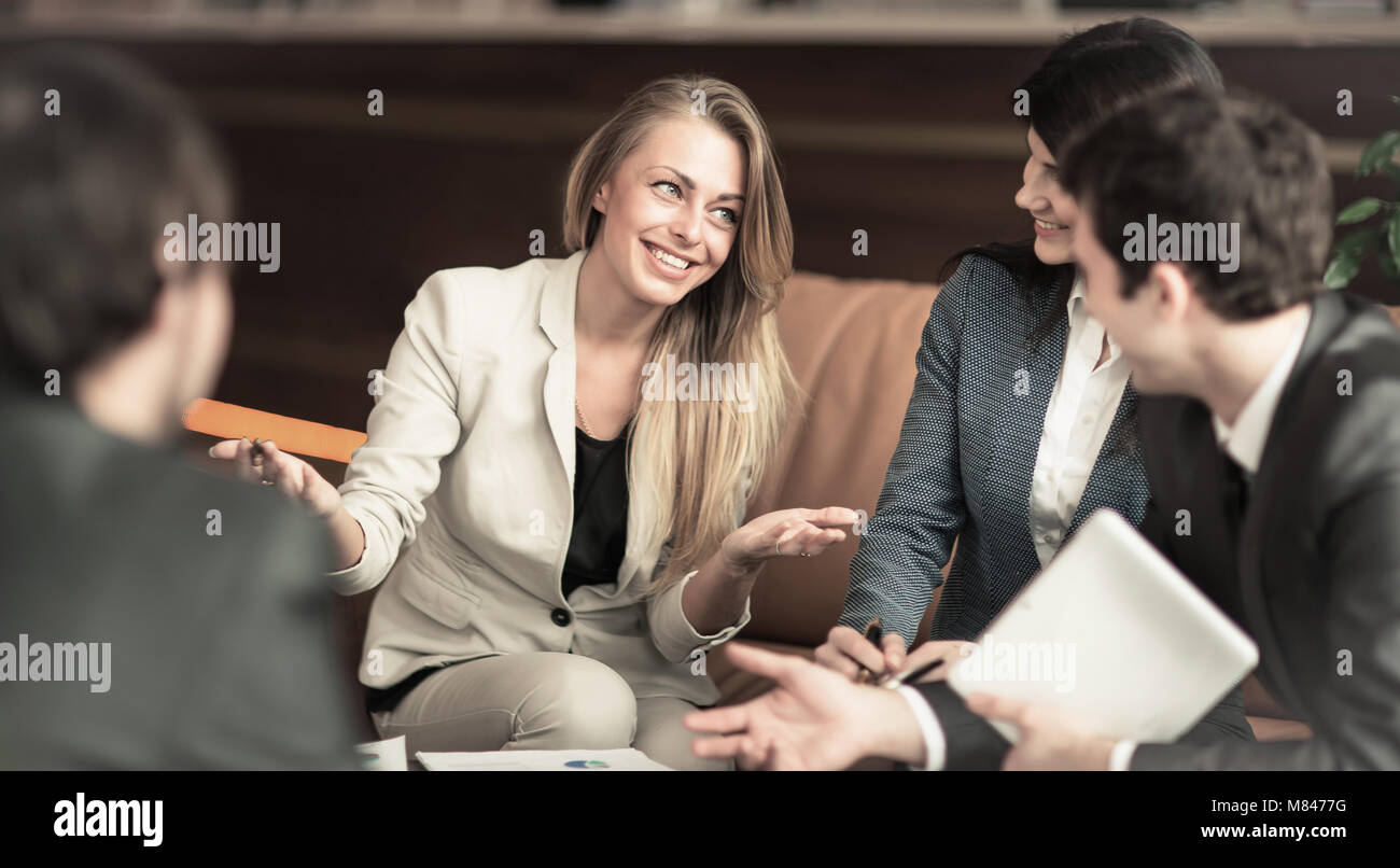 A group of successful businessmen. Discussion of an important issue with colleagues - Stock Image