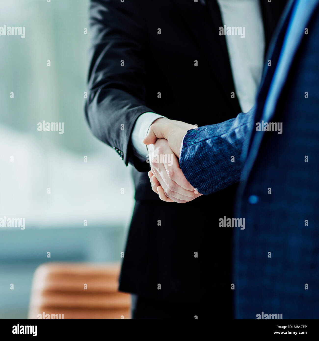 success concept in business - handshake of business partners on the background of the workplace - Stock Image