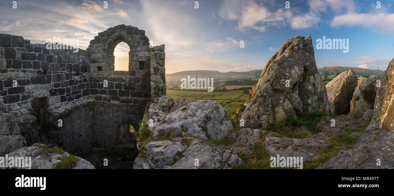 Abandoned ancient stone chapel on the summit of Roche Rock in Cornwall, England. Summer (July) 2017. - Stock Image