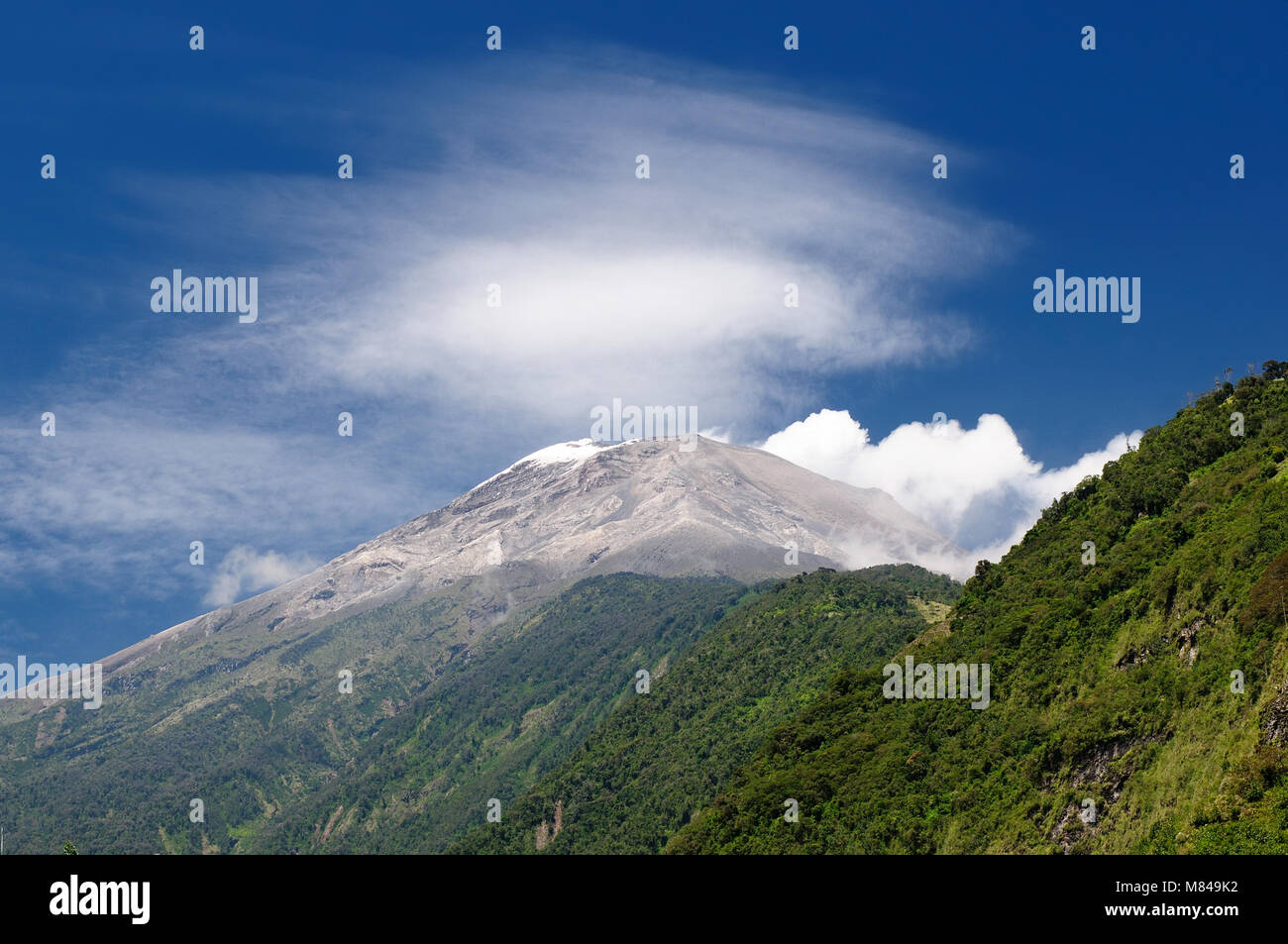 Beautiful landscape in cloud forest near Banos, one of Ecuadors most enticing and popular tourist destination. Volcano - Stock Image