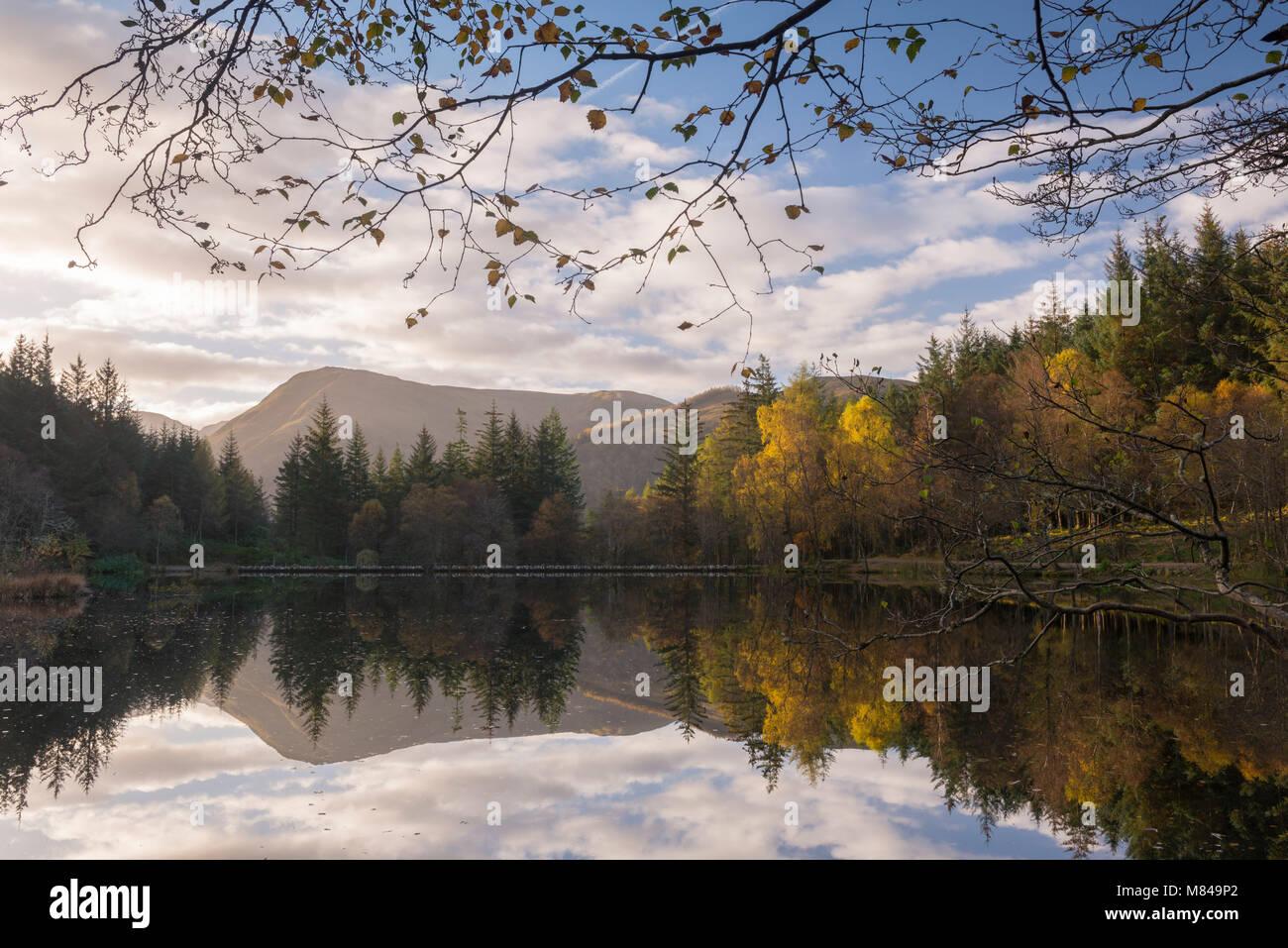 Autumnal reflections on Glencoe Lochan, Glencoe, Scotland, UK. Autumn (October) 2017. - Stock Image