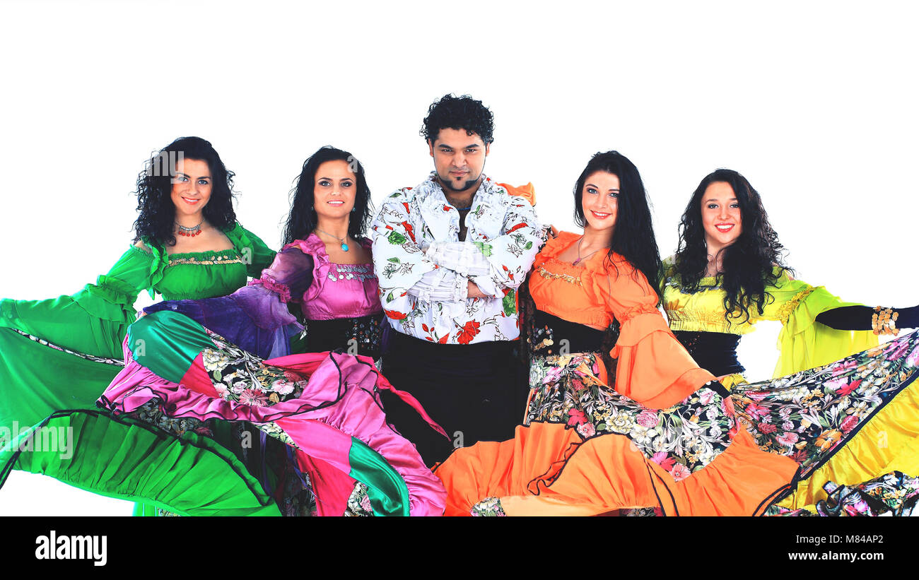 Dance group of gypsies, dancing and waving their magnificent dresses - Stock Image