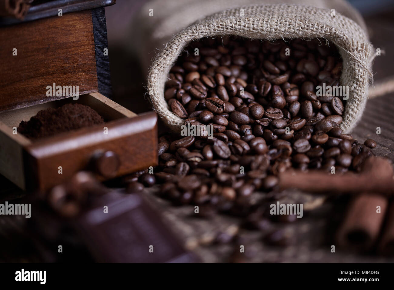Sack of coffee bean and coffee mill - Stock Image