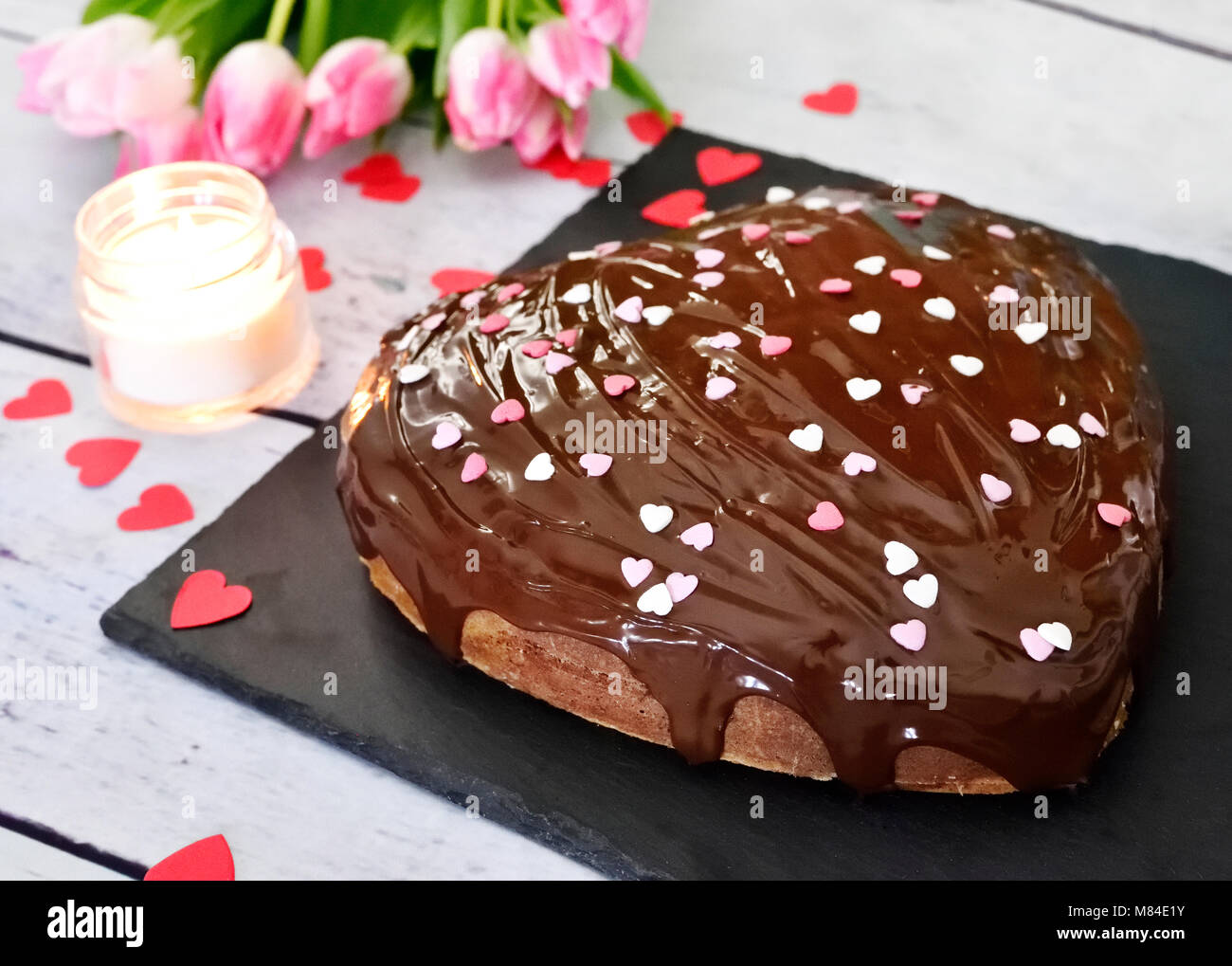 Birthday Cake Or Chocolate Cake With Confetti And Burning Candle