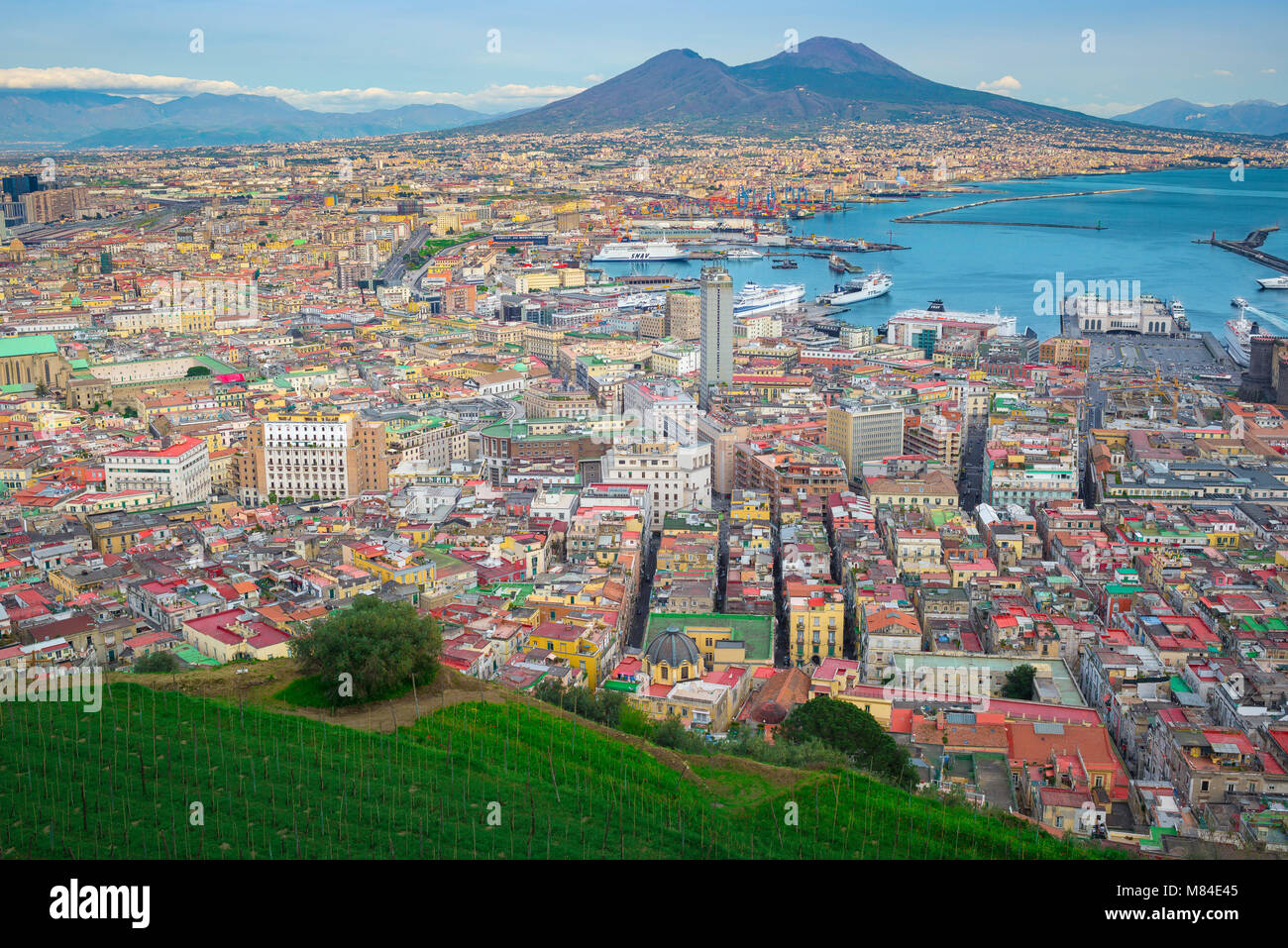 Naples bay, aerial view from the Vomero district of the city and port of Naples with the towering form of Mount - Stock Image