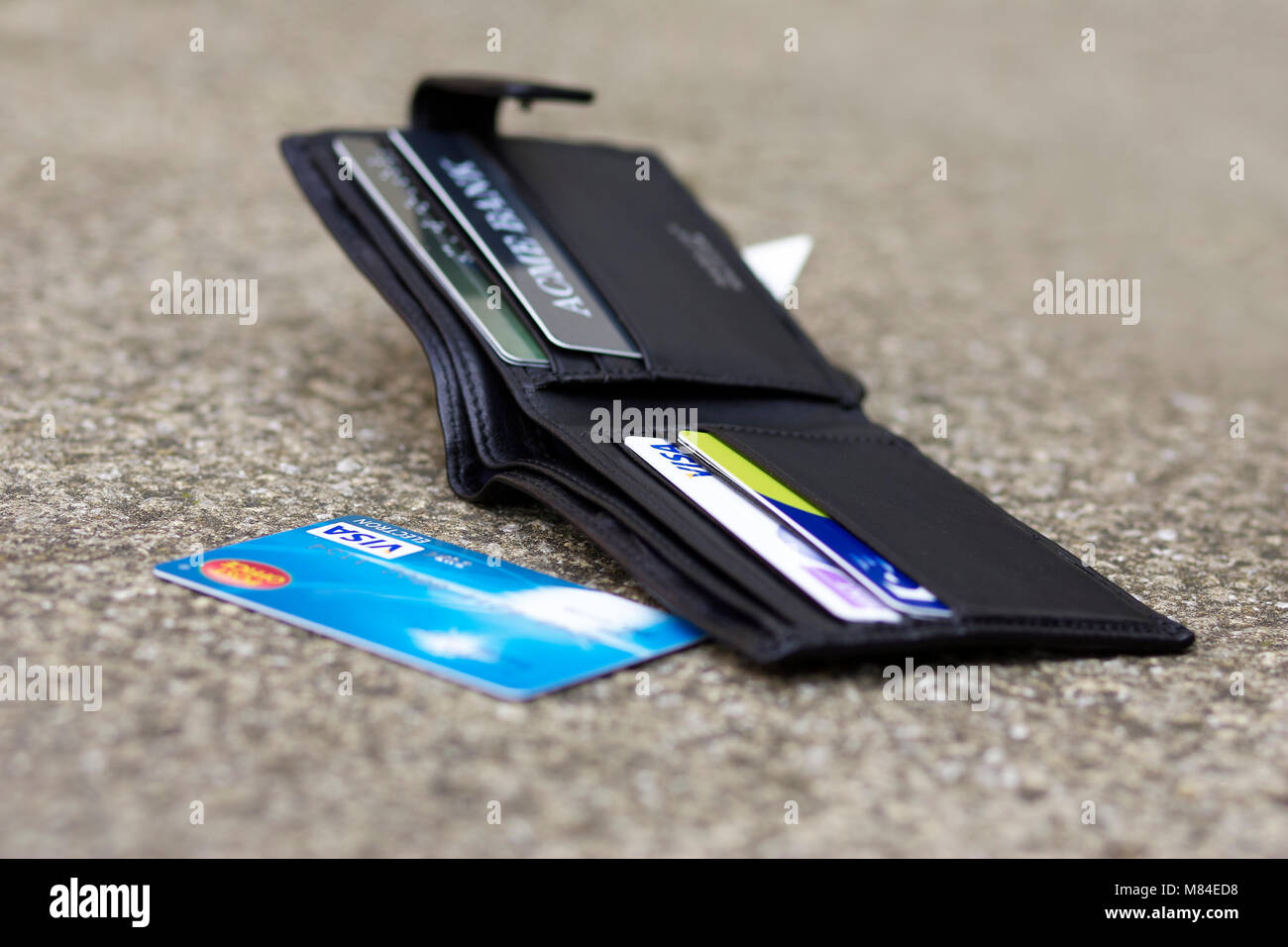 Dropped wallet laid on the floor - Stock Image