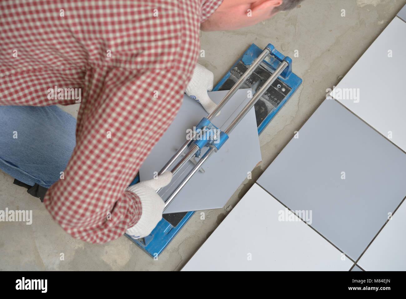 Ceramic tiles tools tiler floor stock photos ceramic tiles tools tiler cutting ceramic tiles during floor installation stock image dailygadgetfo Image collections