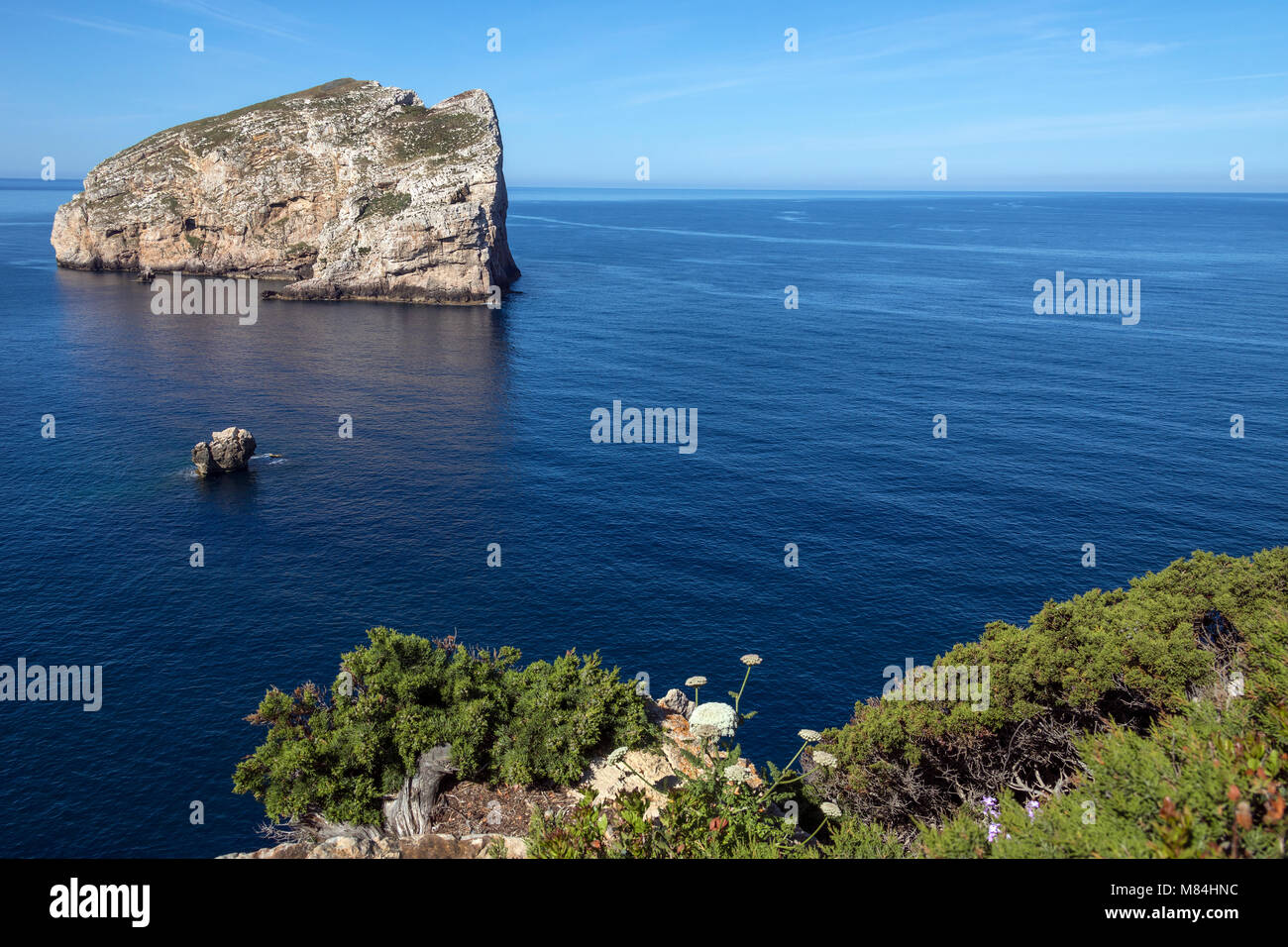 The island of Foradada at Cala Dell Inferno, viewed from the headland of Capo Caccia on the northwest coast of the - Stock Image