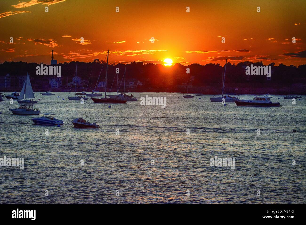 End of the day with a pretty orange sunset. - Stock Image
