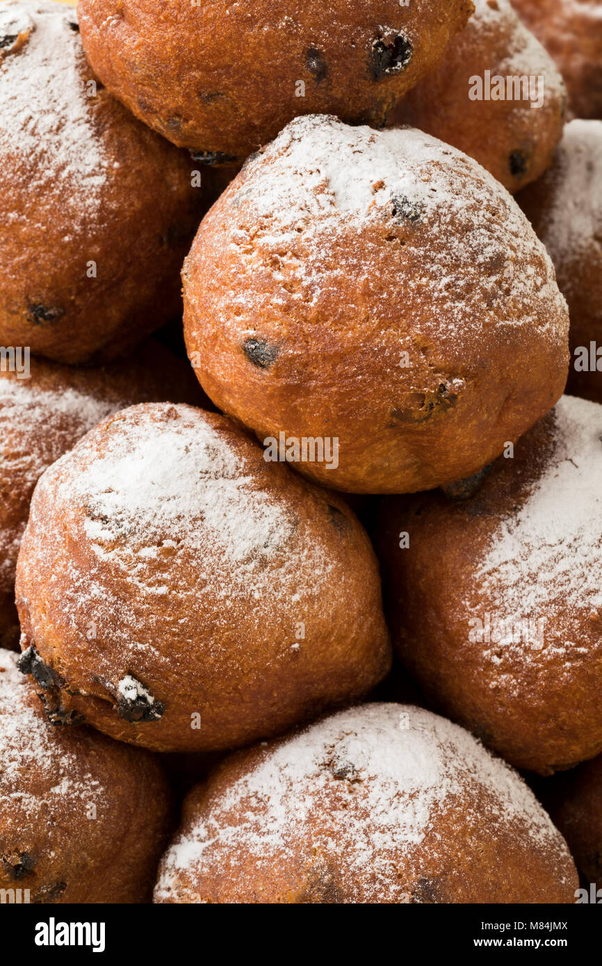 Heap of oliebollen, close up, full frame traditional Dutch pastry for New Year's Eve - Stock Image