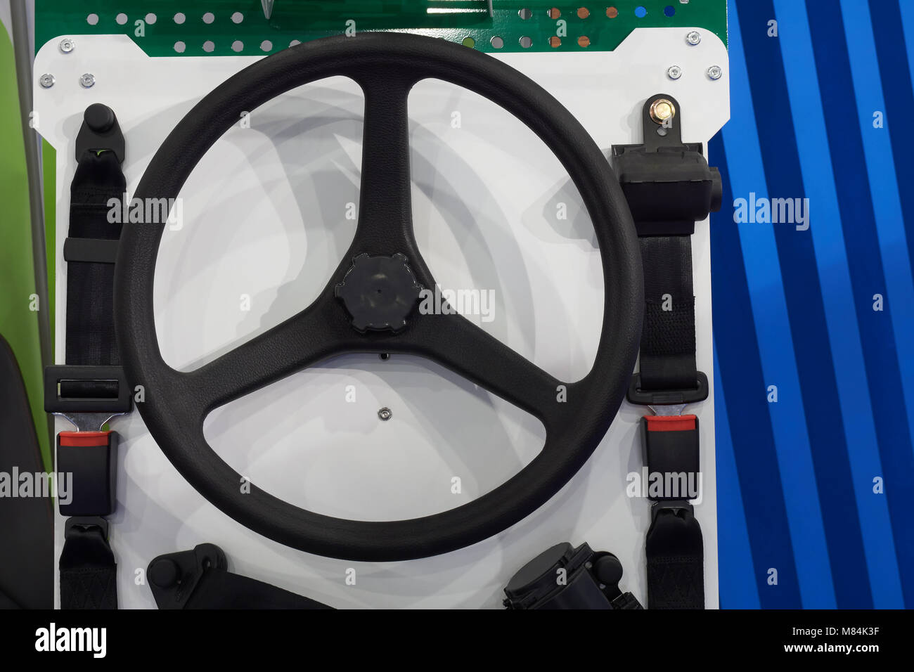 Black plastic wheel and a pair of safety belts - Stock Image