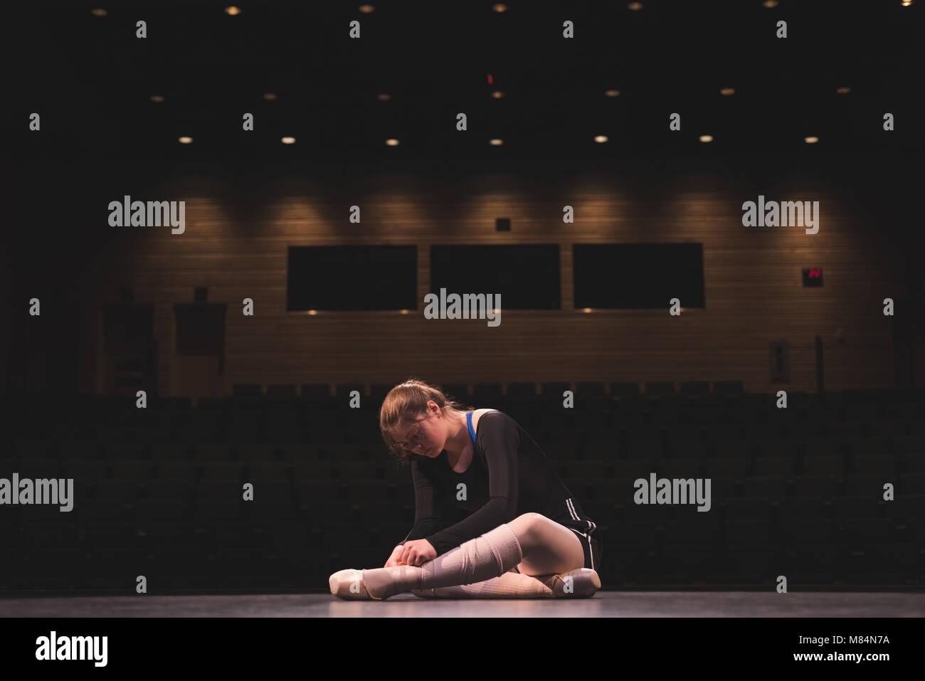 Ballet dancer wearing ballet shoe on stage - Stock Image