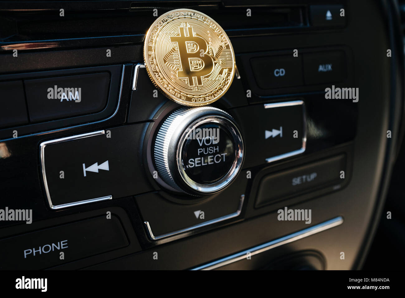 Bitcoin Gold Coin On Cars Dashboard Car Radio