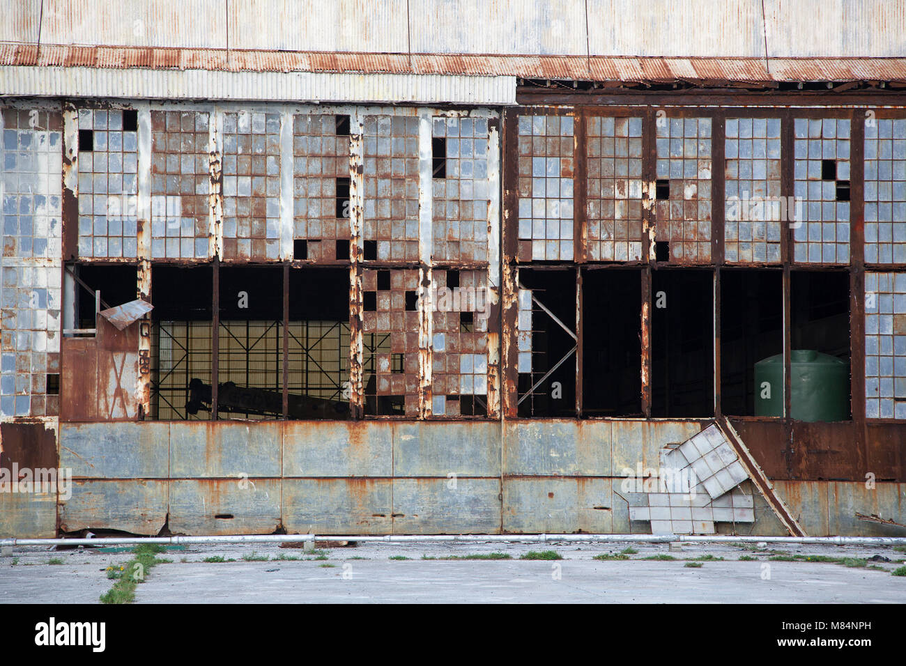 One side of the Midway seaplane hangar shelled in WWII on Dec 7, 1941 and set on fire by Japanese air attack Jun Stock Photo