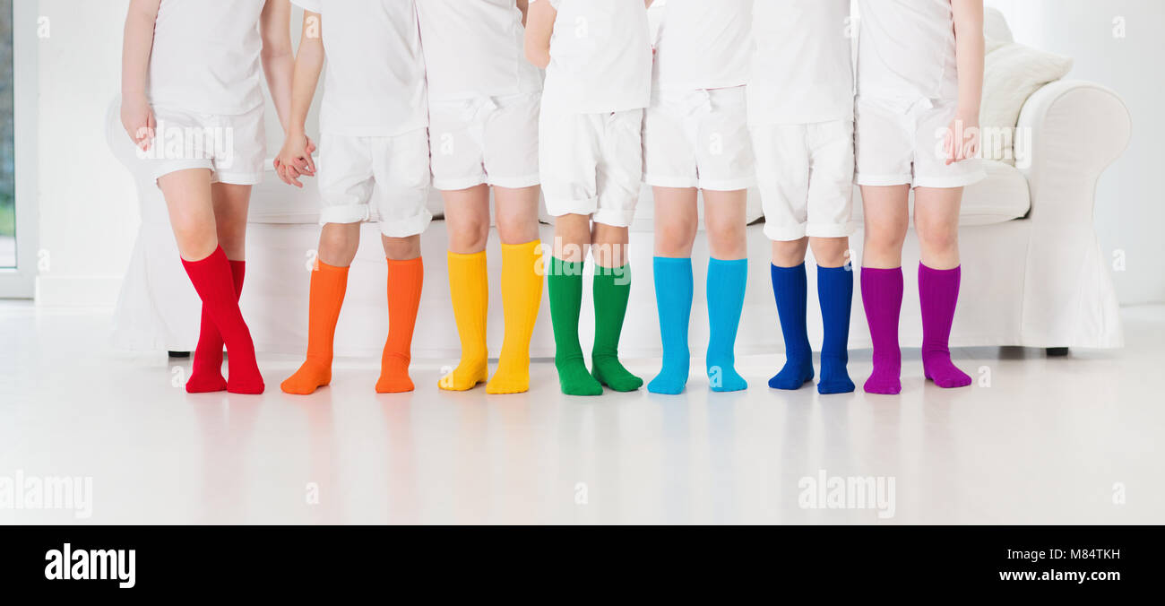 63a20da1d4a Kids wearing colorful rainbow socks. Children footwear collection ...