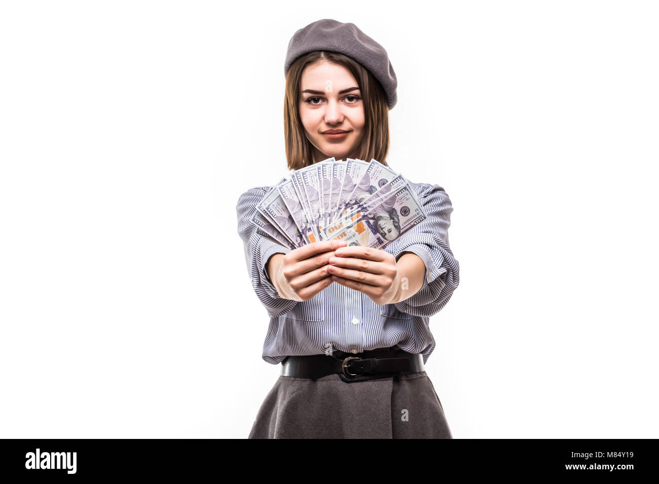 Image of successful woman having french style covering face with fan of money dollar currency isolated over white - Stock Image