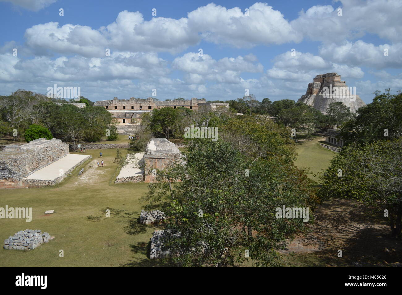 A view of the ruins at Uxmal in Mexico including the Mayan ballcourt and the Pyramid of the Magician - Stock Image