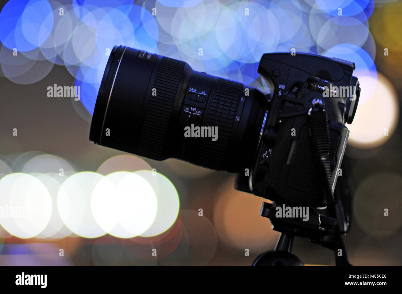 cinematic photography dslr camera equipment blurry bokeh lights in