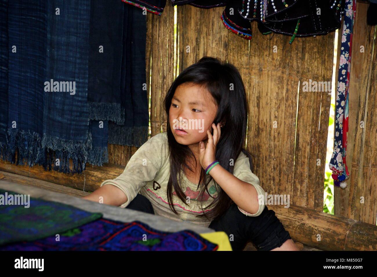 A beautiful Vietnamese girl, a representative of a small ethnic group. National minorities in Sapa. Sapa, Vietnam, Stock Photo