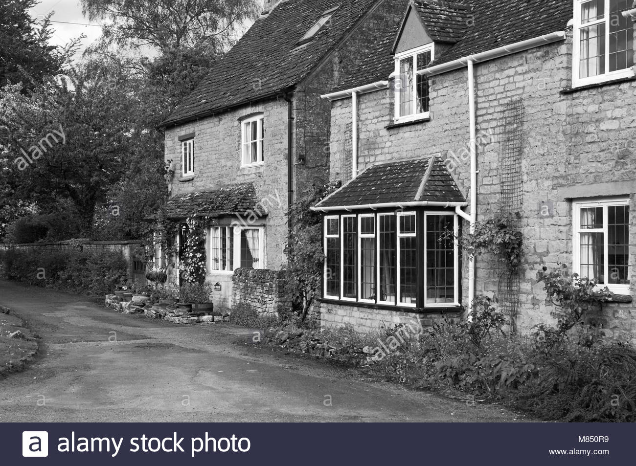 Cotswold stone cottages in bourton on the water england uk - Stock Image