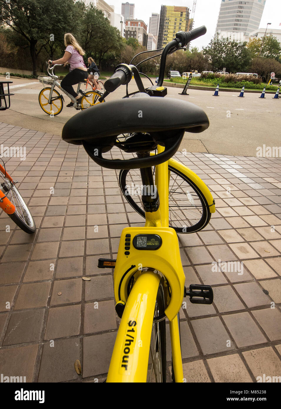 Dockless bike-sharing are showing up in urban cities. In Dallas, Texas, in front of the Reunion Hotel the bikes - Stock Image