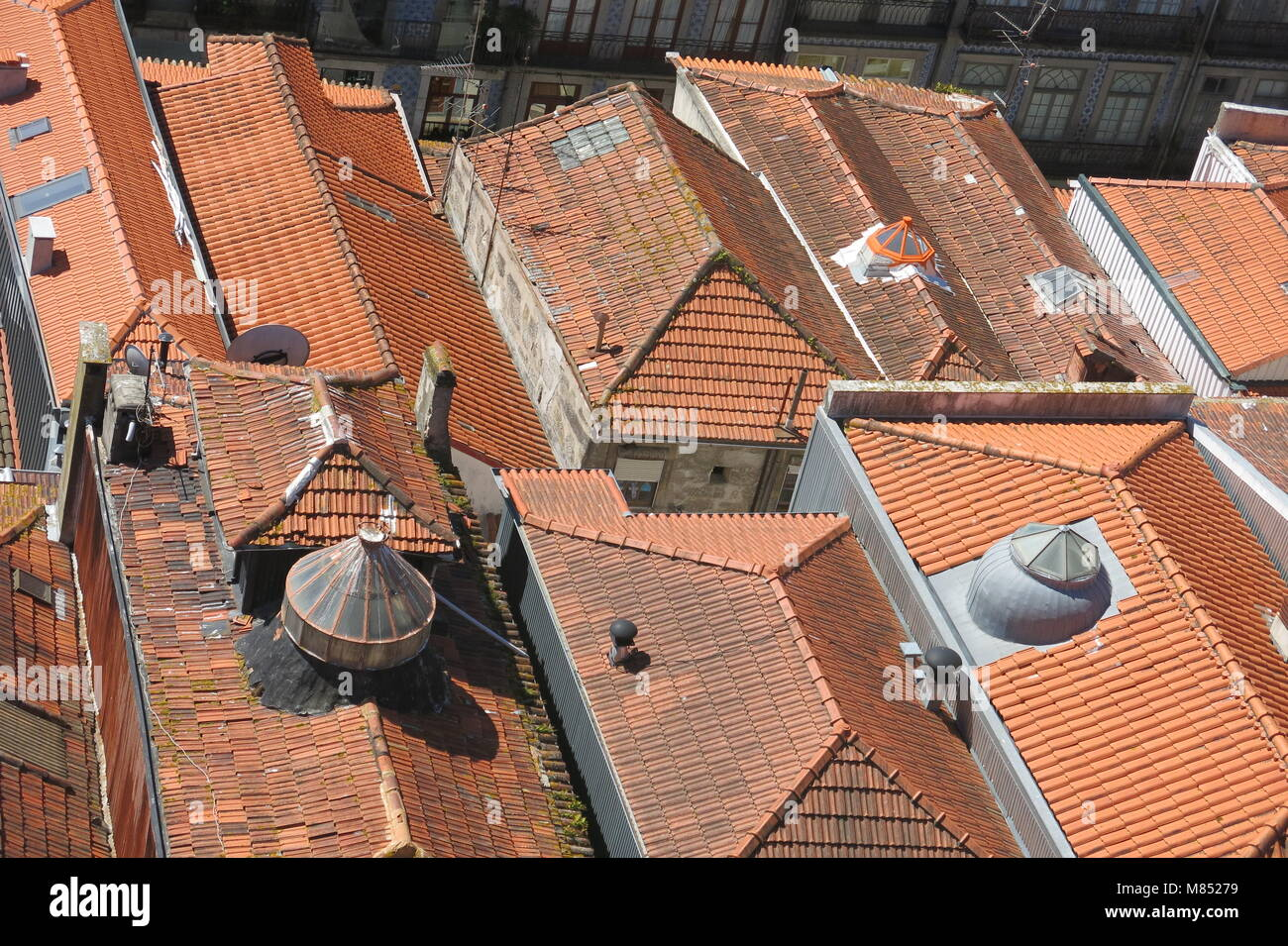 An aerial view of the terracotta tiles and red rooftops of central Porto, taken from the top of the Clerigos Church - Stock Image