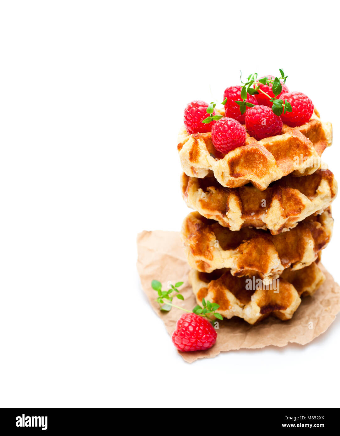 Continental  classics belgian butter waffles with raspberries isolated on white - Stock Image