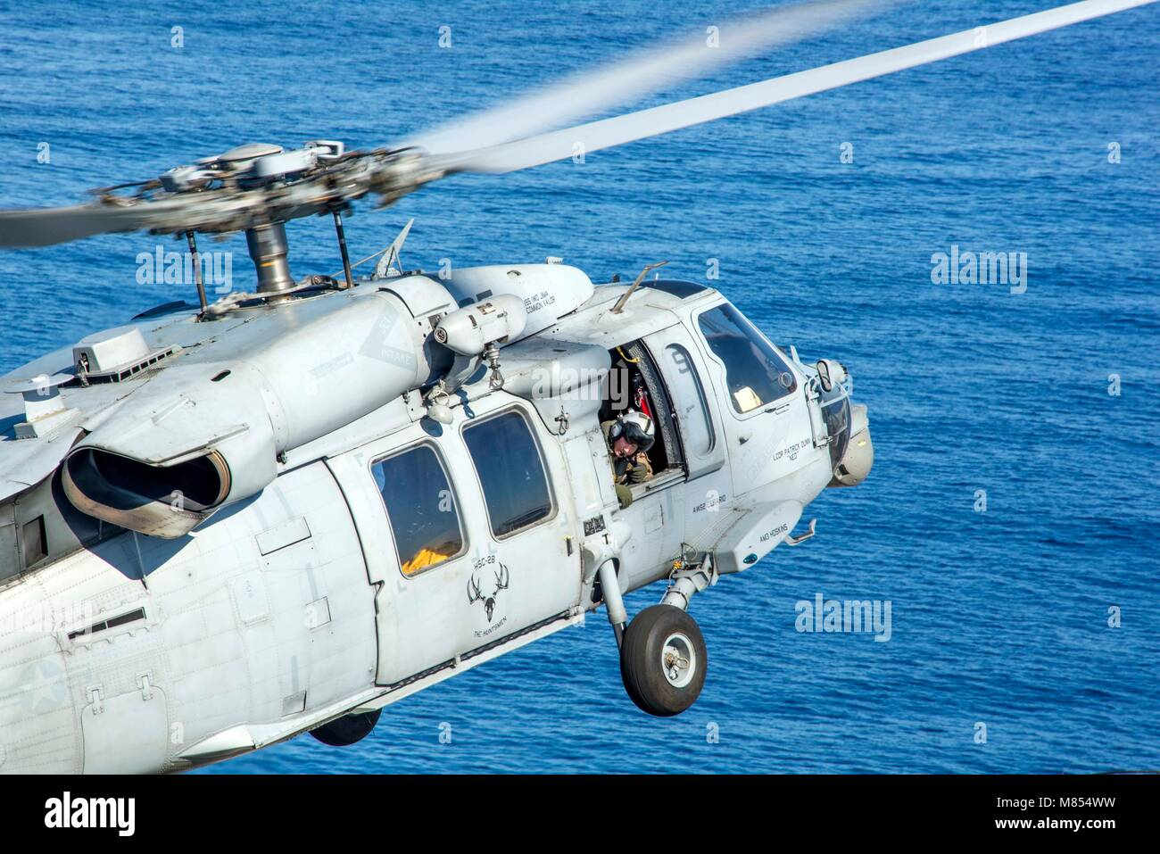 180312-N-JS726-0101 MEDITERRANEAN SEA (March 12, 2018) Naval Air Crewman (Helicopter) 2nd Class Nicholas Morrissey, Stock Photo