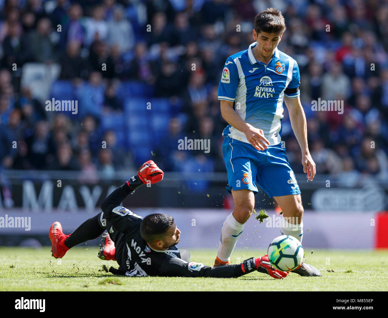 BARCELONA, SPAIN - MARCH 11:  Gerard Moreno, #7 of RCD Espanyol in action with Moya, #25 of Real Sociedad during - Stock Image