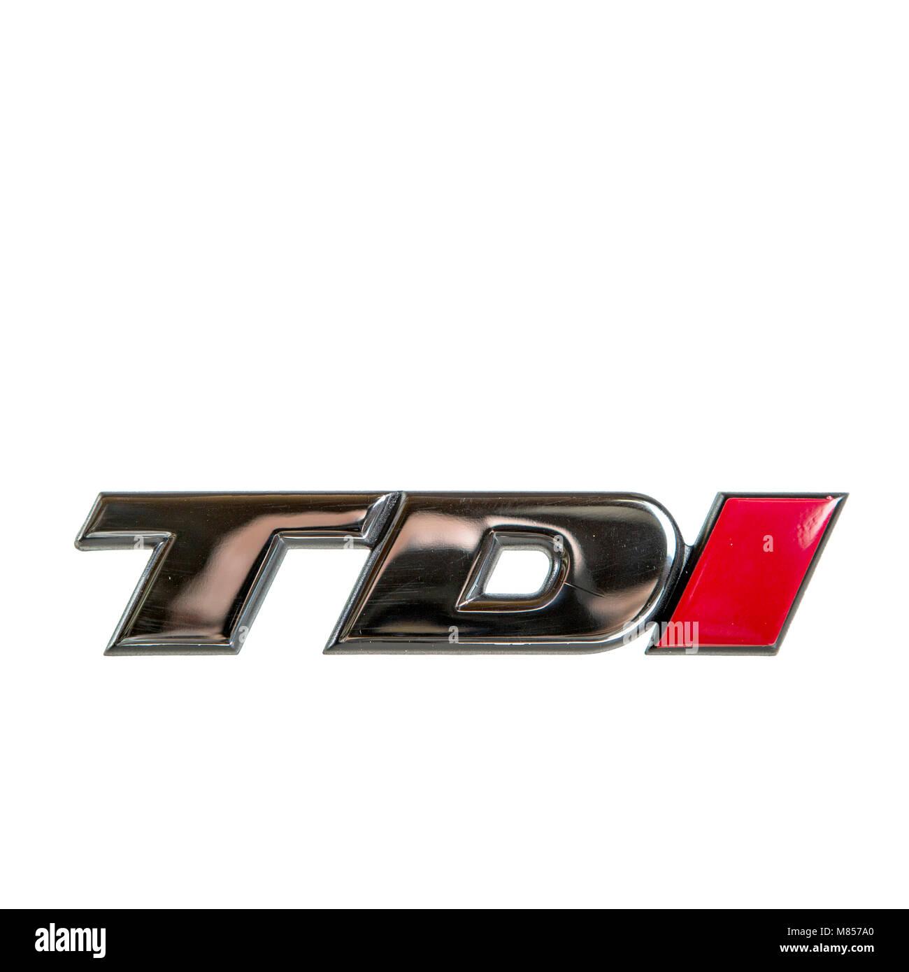 Chromschriftzug TDI mit rotem I von einem Volkswagen. Die drei Buchstaben stehen für die beliebten VW Fahrzeuge - Stock Image