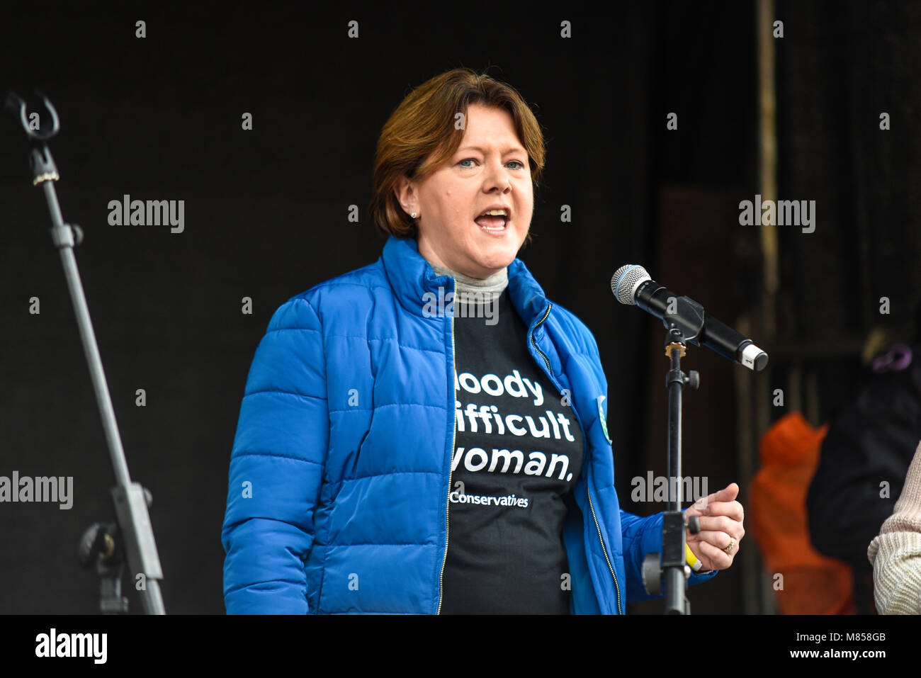 Maria Miller MP speaking at the March 4 Women women's equality protest organised by Care International in London. - Stock Image