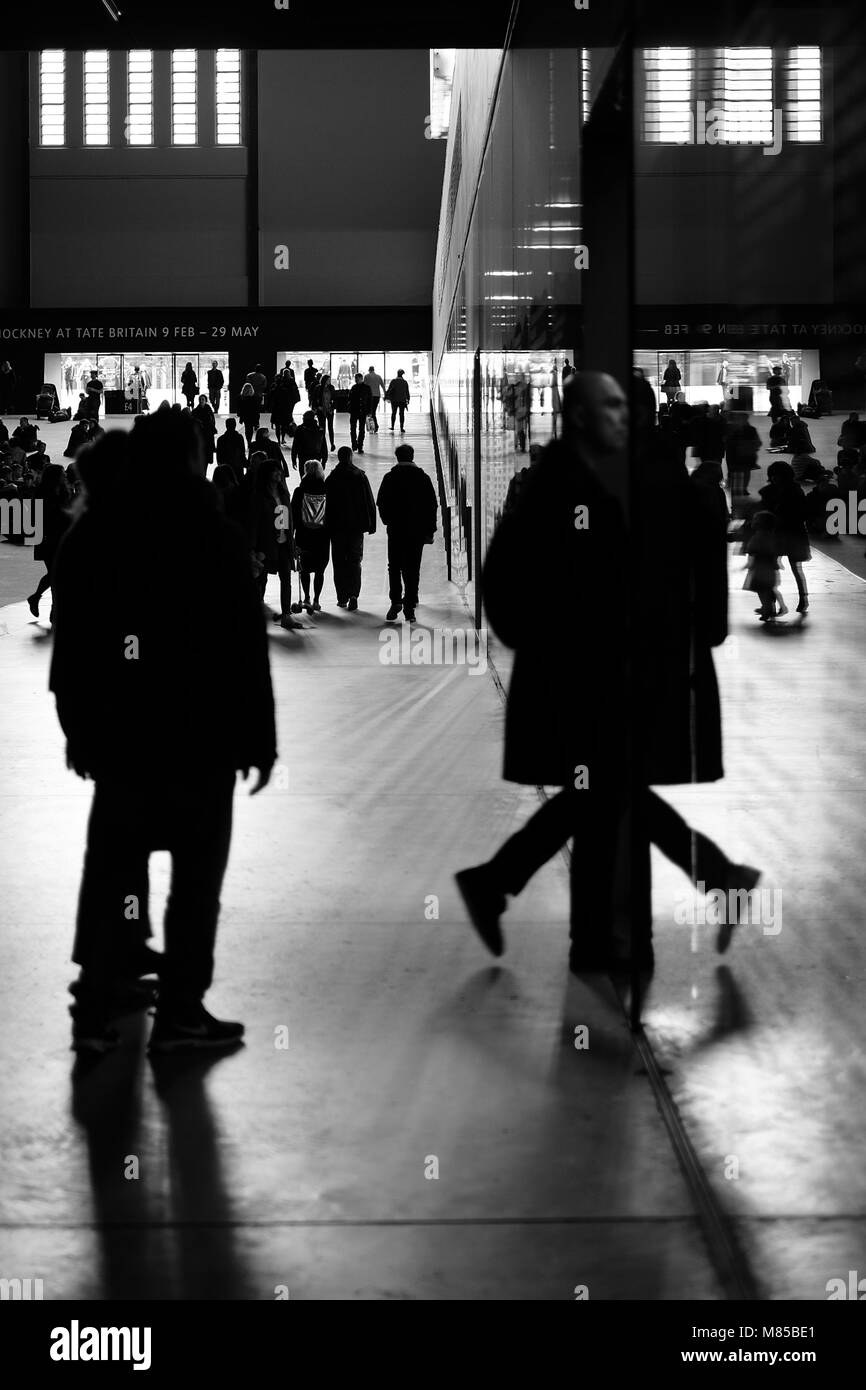 Shadows of people in The Tate's Turbine hall - Stock Image