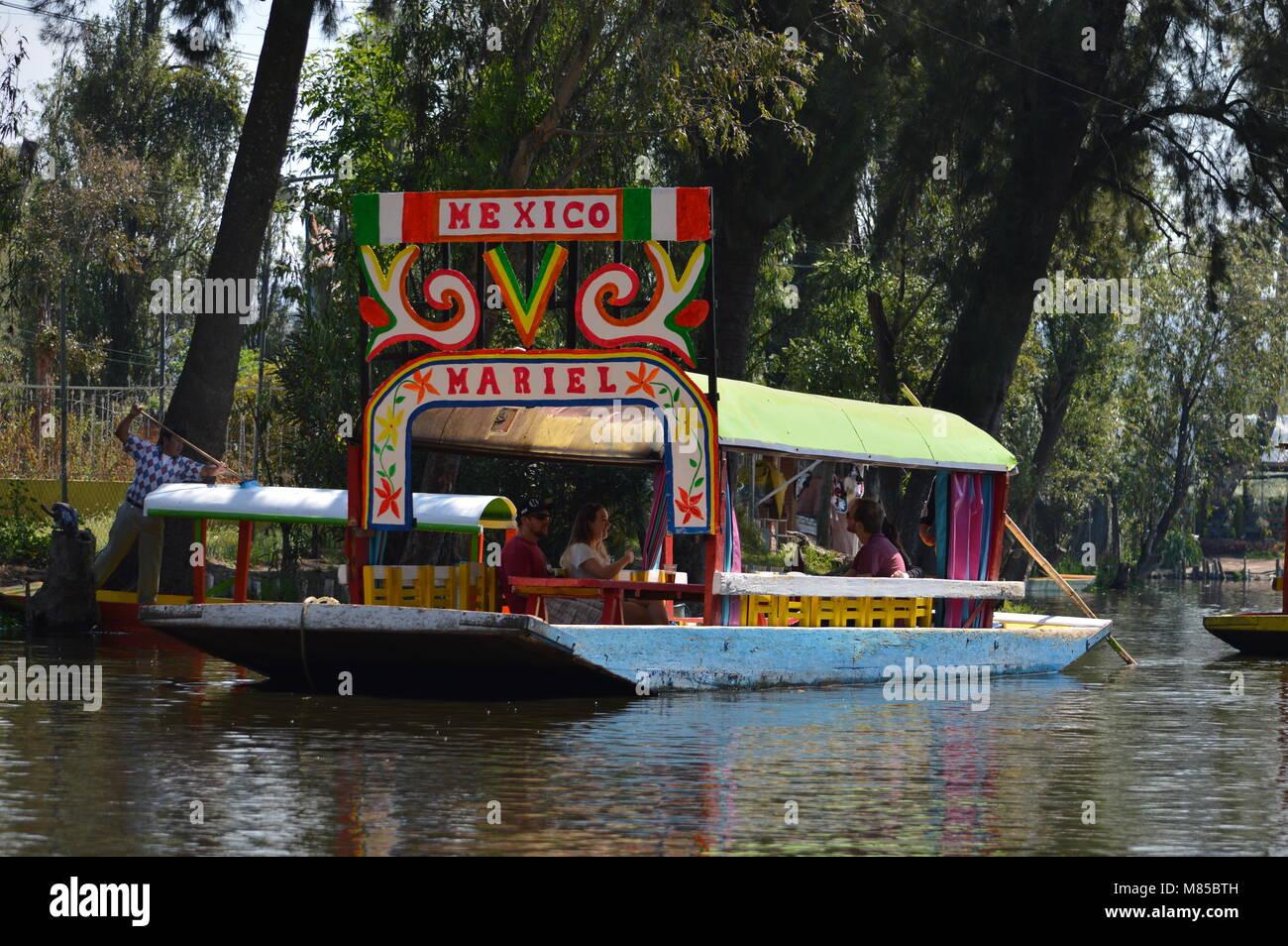 A trajinera in Xochimilco, Mexico City Stock Photo